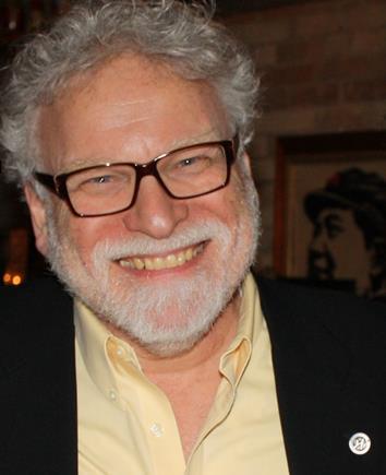 Image of Ken Wyman smiling.